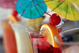 Tropical beverages topped with cocktail umbrella picks.