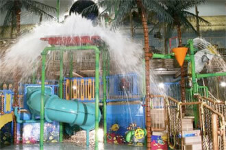 Enormous bucket pours water over kids' waterpark play area
