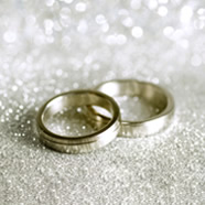 Two wedding rings surrounded by glitter
